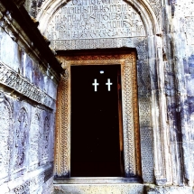 tatev-church-entrance-cross-windows