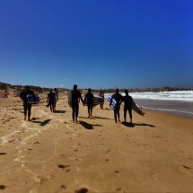 Peniche surfers walking down beach2